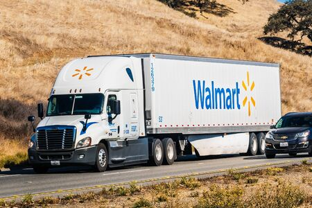Nov 10, 2019 Hollister  CA  USA - Walmart truck driving on the freeway among hills covered in dry grass Sajtókép