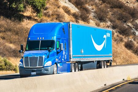 Nov 10, 2019 Hollister  CA  USA - Amazon truck driving on the freeway; the large Prime logo printed on the side