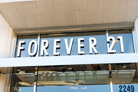 Nov 15, 2019 Pleasanton  CA  USA - Close up of Forever 21 logo at one of their stores located in East San Francisco Bay Area; Forever 21 filed for bankruptcy and will close 350 stores worldwide