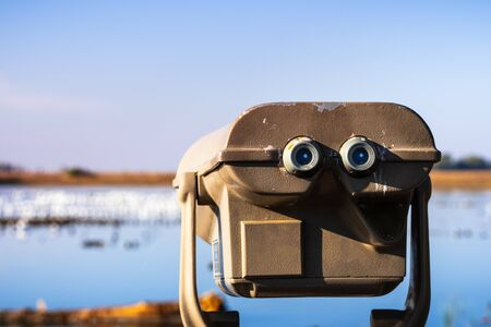 Outdoor daytime viewing telescope looking over the wetlands of Merced National Wildlife Refuge, Central California Stock Photo