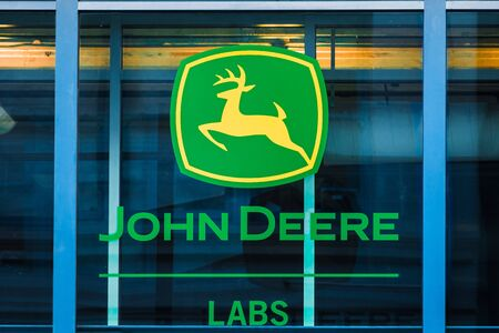 Nov 17, 2019 San Francisco / CA / USA - John Deere sign at their office building; John Deere is the brand name of Deere & Company, an American corporation that manufactures industrial heavy-equipment Editorial
