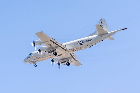 Oct 11, 2019 Sunnyvale / CA / USA - Close up of US Navy Lockheed P-3C Orion aircraft in mid-flight, preparing to land at Moffett Airfield in South San Francisco Bay Area