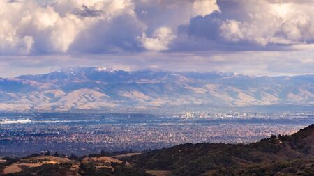 Aerial view San Jose, part of Silicon Valley; snow is visible on top of Mount Hamilton (part of Mount Diablo mountain range); storm clouds cover the sky; San Francisco Bay Area, California Zdjęcie Seryjne