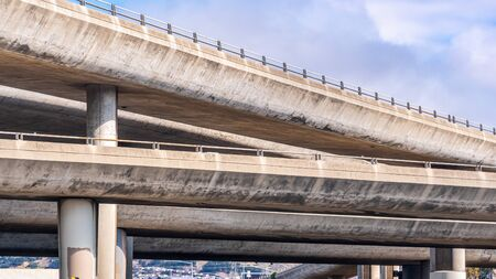 Close up of the concrete ramps of a multilayered freeway interchange in San Francisco bay area, California