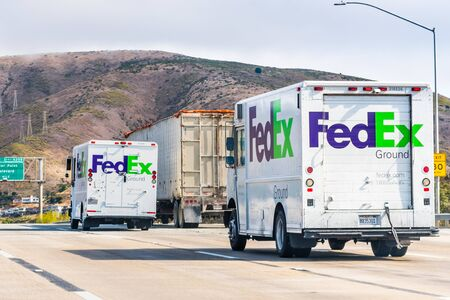 Aug 10, 2019 South San Francisco / CA / USA - FedEx Ground trucks driving on the freeway in San Francisco Bay Area
