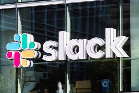 Oct 26, 2019 San Francisco / USA - Slack Technologies, Inc. sign at their HQ in SOMA district; Slack (its main product) is a cloud-based set of collaboration software tools and online services Editorial