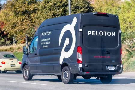Dec 9, 2019 Los Angeles / USA - Peloton minivan driving on the freeway; Peloton Interactive is an American exercise equipment and media company whose main product is a luxury stationary bicycle