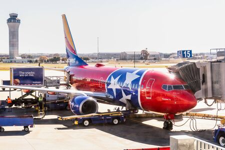 Dec 14, 2019 Austin / TX / USA - Tennessee One Southwest Airlines aircraft (livery honoring and modeled after the Tennessee state flag) docked at Austin-Bergstrom International Airport (AUS);