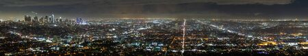 Aerial panoramic night view of Los Angeles metropolitan area; Financial District and the downtown area visible on the left