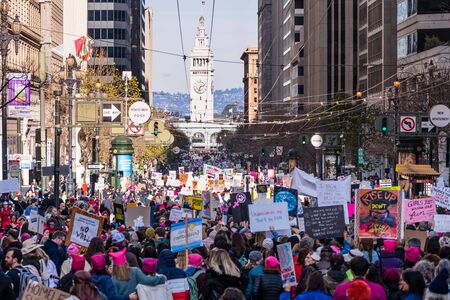 Jan 18, 2020 San Francisco  CA  USA - Participants to the Womens March event hold signs with various messages while marching on Market street towards the Embarcadero; Redakční