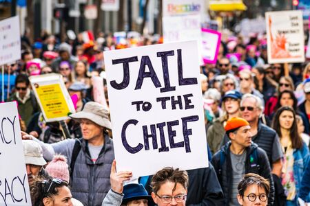 Jan 18, 2020 San Francisco  CA  USA - Participant to the Womens March event holds Jail to the Chief sign while marching on Market street in downtown San Francisco