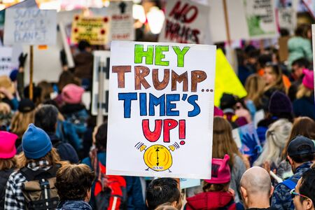 Jan 18, 2020 San Francisco  CA  USA - Participant to the Womens March event holds Hey Trump... Times Up! sign while marching on Market street in downtown San Francisco Editöryel