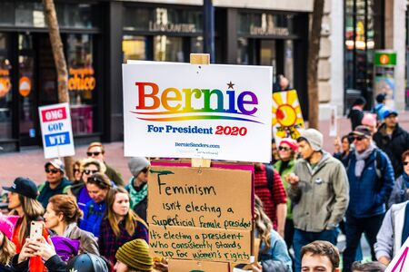 Jan 18, 2020 San Francisco  CA  USA - Participant to the Womens March event holds Bernie for President 2020 sign while marching on Market street in downtown San Francisco Redakční