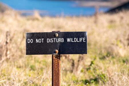 Do not disturb wildlife sign posted in a national park, California