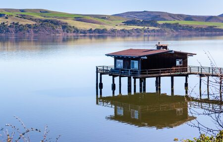 House on stilts on the shoreline of Tomales Bay, North San Francisco Bay Area, California