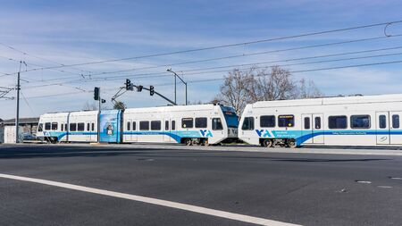 Jan 30, 2020 Santa Clara / CA / USA - VTA Train Not In service crossing an intersection in south San Francisco bay; VTA Light Rail is a system serving San Jose and surrounding cities in Silicon Valley