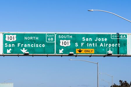 Freeway interchange in San Francisco Bay Area; Freeway signage providing information about the lanes going to 101 North towards San Francisco and 101 South towards San Jose and SFO