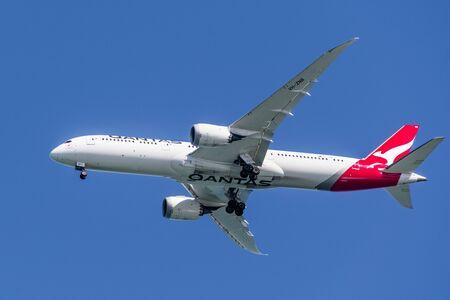 Feb 19, 2020 San Francisco / CA / USA - Qantas Airways aircraft preparing for landing at San Francisco International Airport (SFO); the Qantas logo visible on the underbelly
