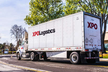 Feb 27, 2020 San Jose / CA / USA - XPO Logistics truck making deliveries; XPO Logistics, Inc. is one of the 10 largest providers of transportation and logistics services in the world