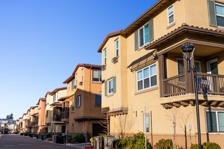 Exterior view of a row of identical townhouses; Sunnyvale, San Francisco bay area, California