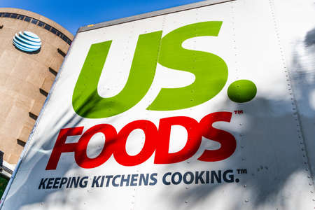Sep 3, 2019 San Jose / CA / USA - Close up of US Foods logo printed on the side of a trailer truck; US. Foods is an American food-service distributor Redakční