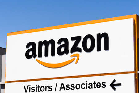 Aug 23, 2019 Sacramento / CA / USA - Amazon logo and Smile symbol displayed at one of their fulfillment centers; direction towards the entrance for visitors and associates indicated below