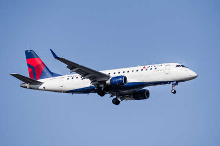 Mar 13, 2020 San Jose / CA / USA - Delta Connections aircraft preparing for landing; blue sky background; Delta Connection is a regional airline brand name for Delta Air Lines