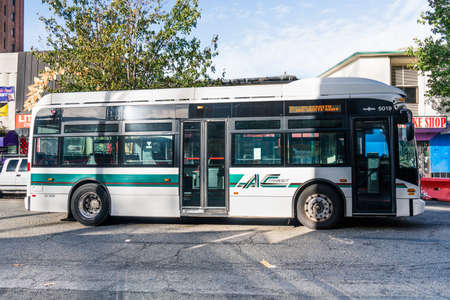 Oct 18, 2019 Berkeley / CA / USA - Side view of an AC Transit bus; AC Transit is a public transit agency serving the western portions of Alameda and Contra Costa counties in East San Francisco Bay