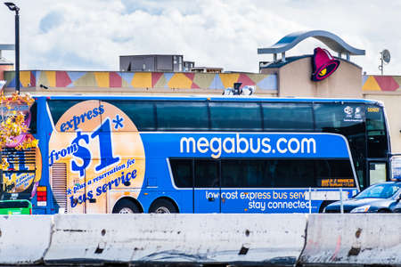 Dec 8, 2019 Lost Hills / CA / USA - Megabus stopped at an I5 rest area en route to Los Angeles; Megabus, branded as megabus.com, is an intercity bus service of Coach USA / Coach Canada and DATTCO
