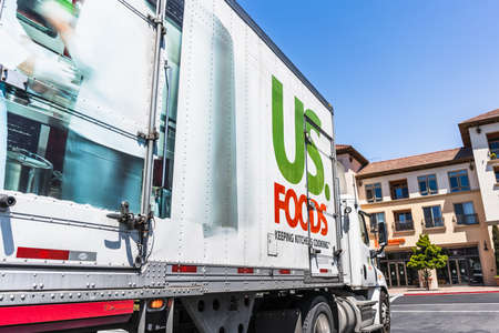 May 5, 2020 Santa Clara / CA / USA - US Foods truck driving on a street in San Francisco bay; US. Foods is an American food-service distributor Editorial