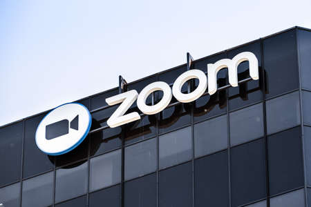 May 6, 2020 San Jose / CA / USA - Close up of Zoom sign at their headquarters in Silicon Valley; Zoom Video Communications is a company that provides remote conferencing services using cloud computing