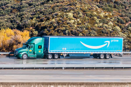 December 8, 2019 Los Angeles / CA / USA - Amazon truck driving on the interstate, the large Prime logo printed on the side