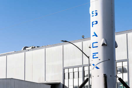 Dec 8, 2019 Hawthorne / Los Angeles / CA / USA - SpaceX (Space Exploration Technologies Corp.) headquarters; Falcon 9 rocket displayed in the front; SpaceX is a private American aerospace manufacturer Editorial