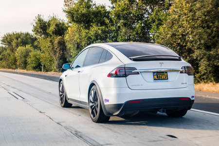 May 10, 2020 Cupertino / CA / USA - Tesla Model X travelling on the freeway in Silicon Valley; South San Francisco bay area