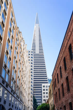 Nov 17, 2019 San Francisco / CA / USA - Transamerica Pyramid rising at the end of a narrow street with old fashioned office buildings in the Financial District
