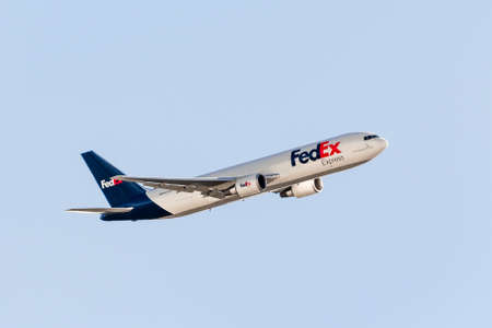 May 29, 2020 Sunnyvale / CA / USA - FedEx Express aircraft in mid flight, its logo and tagline displayed on the fuselage; FedEx Express is an American cargo airline, subsidiary of FedEx Corporation