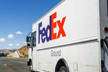 Jun 6, 2020 San Jose / CA / USA - FedEx truck driving on the freeway in South San Francisco bay area Editorial