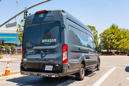 June 4, 2020 / CA / USA - Amazon van branded with the Amazon Prime logo, making deliveries in San Francisco bay area