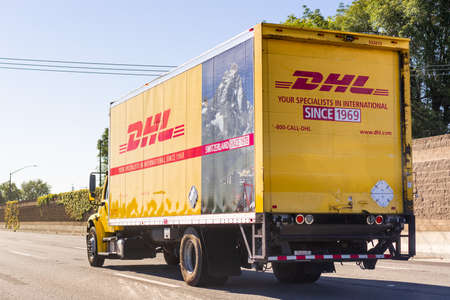 June 18, 2020 Redwood City / CA / USA - DHL truck driving on the freeway; DHL (Dalsey, Hillblom and Lynn) International GmbH is an American-founded German courier, parcel, and express mail service