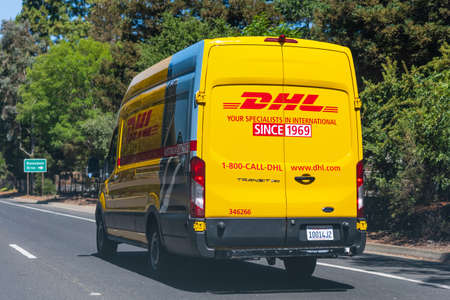 July 1, 2020 Mountain View / CA / USA - DHL van driving on the freeway, DHL (Dalsey, Hillblom and Lynn) International GmbH is an American-founded German courier, parcel, and express mail service