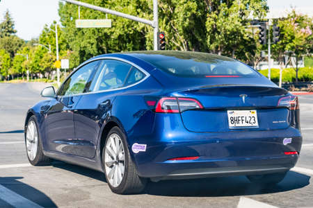 July 9, 2020 Sunnyvale / CA / USA - Tesla Model 3 waiting at a traffic light in Silicon Valley