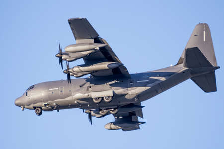 July 9, 2020 Mountain View / CA / USA - Close up of US Air Force military aircraft preparing for landing at Moffett Federal Airfield in Silicon Valley