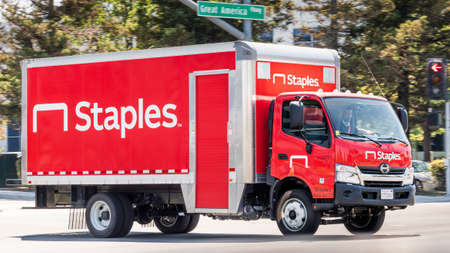 July 16, 2020 Santa Clara / CA / USA - Staples truck driving on a street in San Francisco Bay Area; Staples Inc. is a private American office retail company