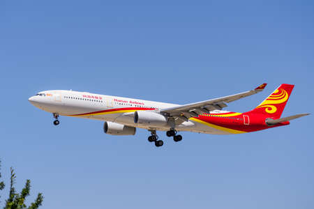 July 23, 2020 San Jose / CA / USA - Hainan Airlines Dreamliner arriving at San Jose Mineta International airport, Silicon Valley; Hainan Airlines Co., Ltd. is the fourth-largest Chinese airline