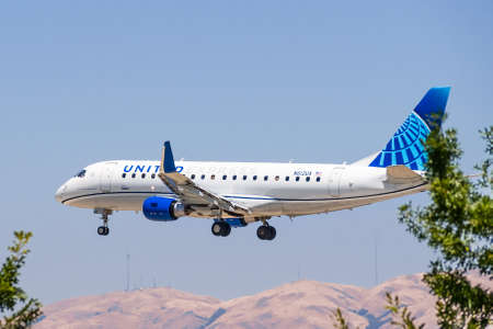 July 23, 2020 San Jose / CA / USA - United Express (the regional branch of United Airlines) aircraft wearing the new livery, landing at San Jose Mineta International airport, Silicon Valley 新闻类图片