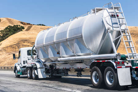 Tanker truck driving on the freeway through the hills of Alameda County, East San Francisco Bay Area, California