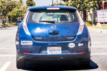 July 28, 2020 Sunnyvale / CA / USA - Back view of Nissan Leaf driving through a residential neighborhood in south San Francisco bay area, Silicon Valley