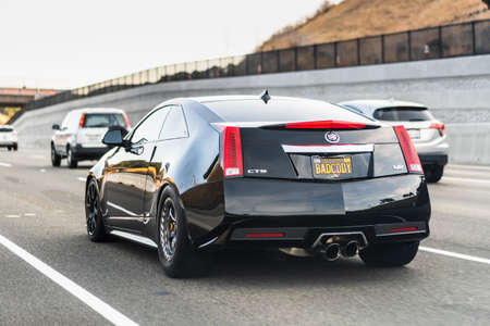July 25, 2020 Fremont / CA / USA - Cadillac CTS-V coupe driving on the freeway; The Cadillac CTS-V is a high-performance version of the Cadillac CTS 新闻类图片