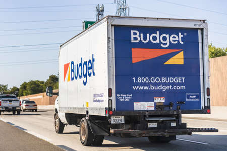 July 25, 2020 Concord / CA / USA - Budget truck driving on the freeway; Budget Truck Rental, LLC is a subsidiary of Avis Budget Group, Inc.