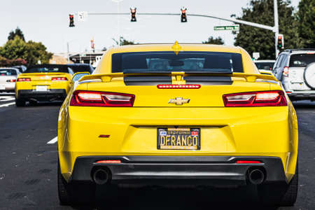 August 1, 2020 Fremont / CA / USA - Close up of yellow Chevrolet Camaro driving through the city; East San Francisco bay area